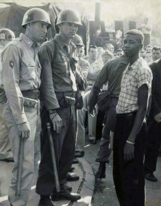 Two Arkansas National Guard members face Terrence Roberts at Little Rock Central High School on September 23 1957